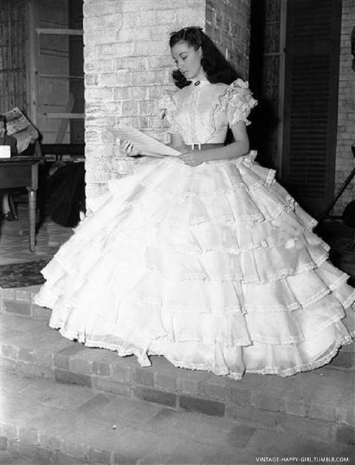 On the set of Gone With The Wind, Vivien Leigh checks her script for the opening scene at Tara.