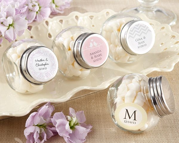 Our Mini Glass Personalized Favor Jar Wedding Favors (Set of 12) will bring back old memories of sweet shops, all while you create new ones with your closest friends and family! Perfect as your wedding favors, these custom candy jars are just the thing you need to hold tiny treats such as mints, chocolate candies, bubble gum and much more. You can even fill them up with spices or loose tea for a different kind of gift.Each set contains 12 old-fashioned design candy jars made of clear glass…