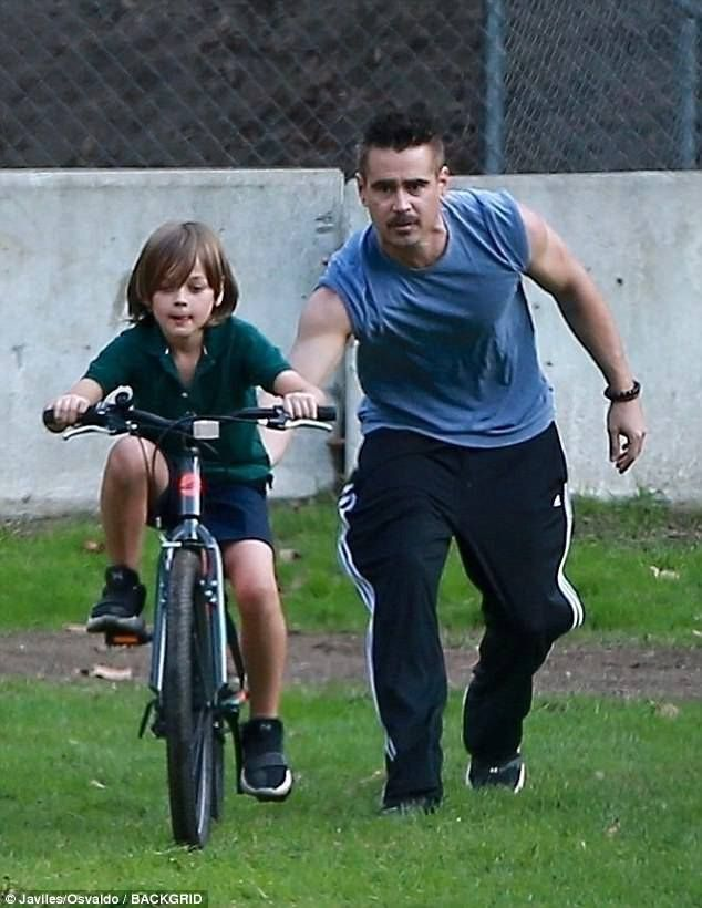 Colin Farrell helping his son Henry ride a bike❤️