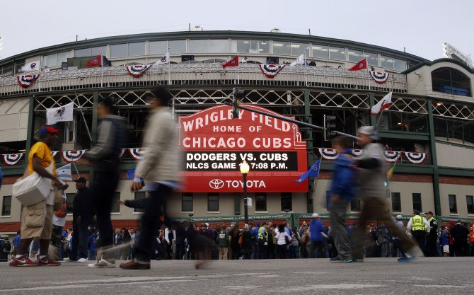Writer Karen Stabiner, not wanting to be a jink, promises she will not watch the Cubs in any of the World Series games. / AP