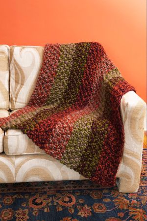 Brighten up your decor with this striped moss stitch afghan.