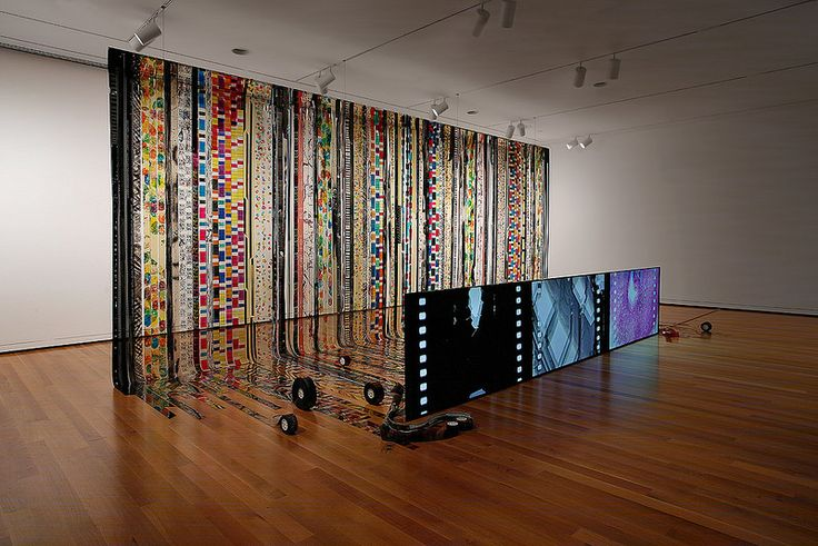 Jennifer West - Film is Dead, 2016. Installation View. 70mm Filmstrips, dye, ink, food coloring, spray paint, nail polish, salt, mud, film cores, 16 and 35mm filmstrips.. Seattle Art Museum, Seattle, Washington, November 17th, 2016 - May 7th, 2017 Photo: Mark Woods