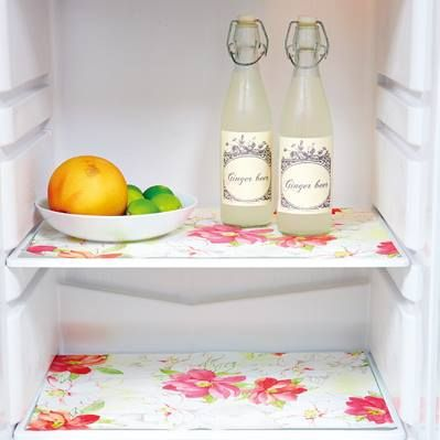 Line your fridge shelves with oilcloth. It looks pretty, is easy to keep clean and protects the glass.