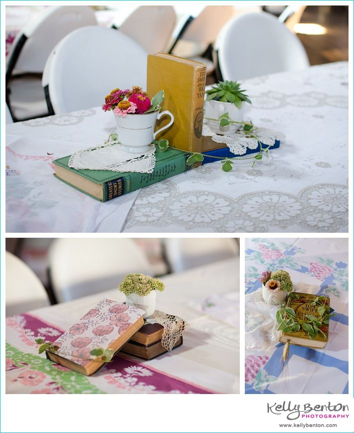 Wedding table decorations - old books, dried flowers, mismatched tea cups, and tablecloths.