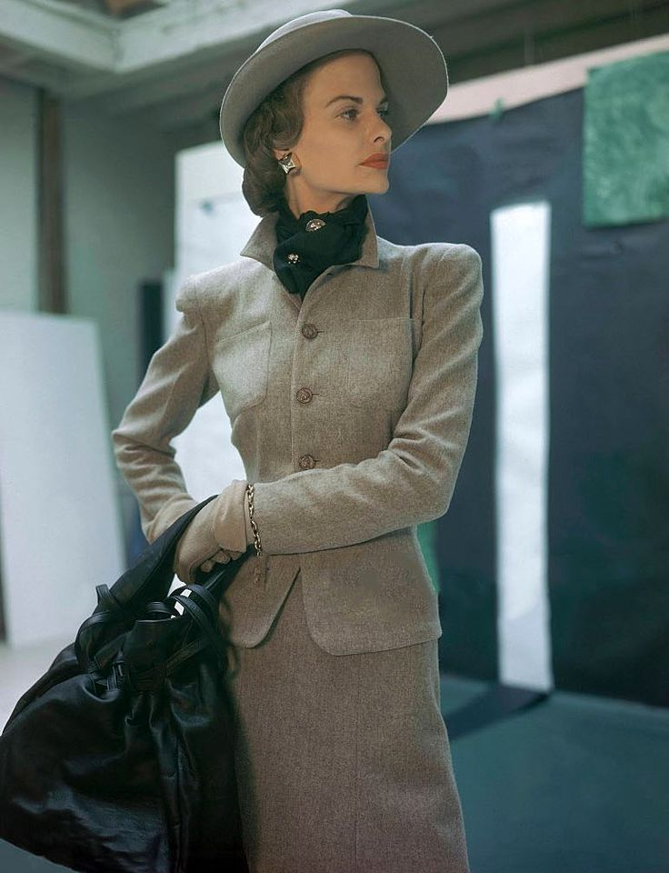 Dorothy Tivis wearing sand-colored flannel suit buttoned with coins by Sacony,Vogue 1946