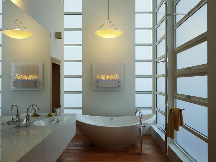 http://www.drissimm.com/wp-content/uploads/2014/12/elegant-modern-electric-fireplace-design-set-on-the-wall-bathroom-with-amazing-lighting-pendant-lamp-as-well-unique-bathtub-on-wooden-floor-and-wide-glass-window-and-white-vanity-sink.jpg