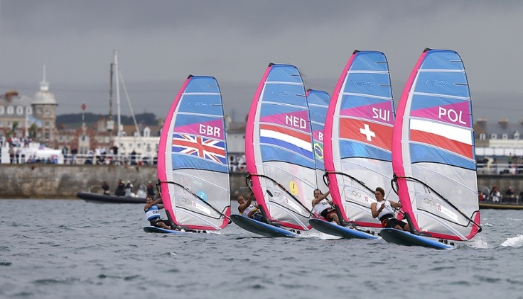 Nick Dempsey of Great Britain, Dorian Van Rijsselberge of Netherlands, Richard Stauffacher of Switzerland and Przemyslaw Miarczynski of Poland, from left to right, sail on the start of the medal RS:X race at the London 2012 Summer Olympics, Tuesday, Aug. 7, 2012, in Weymouth and Portland, England. (AP Photo/Francois Mori)