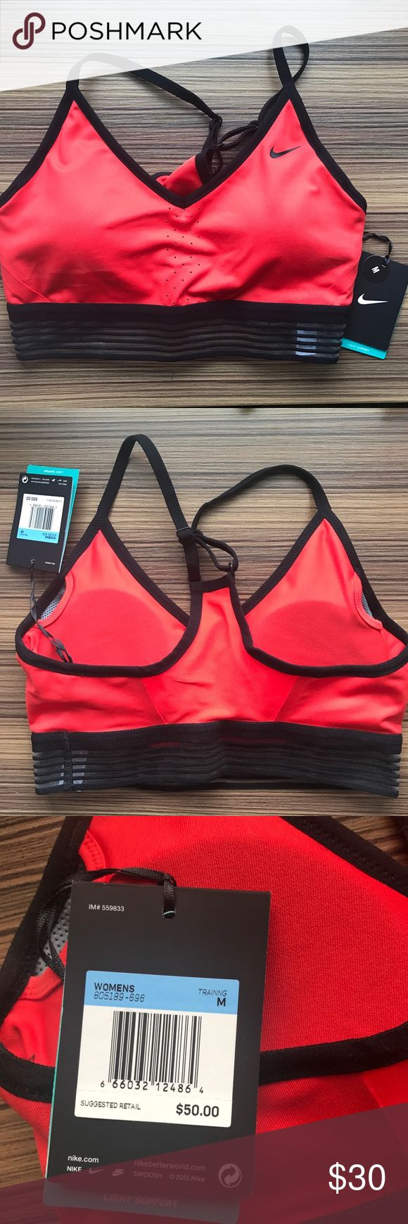 BRAND NEW Nike Sports Bra! New never worn. All original tags are attached. Size Medium red sports bra with removable pads. Originally listed as $50. The lining at the bottom is sheer but the bra itself is not. Nike Intimates & Sleepwear Bras