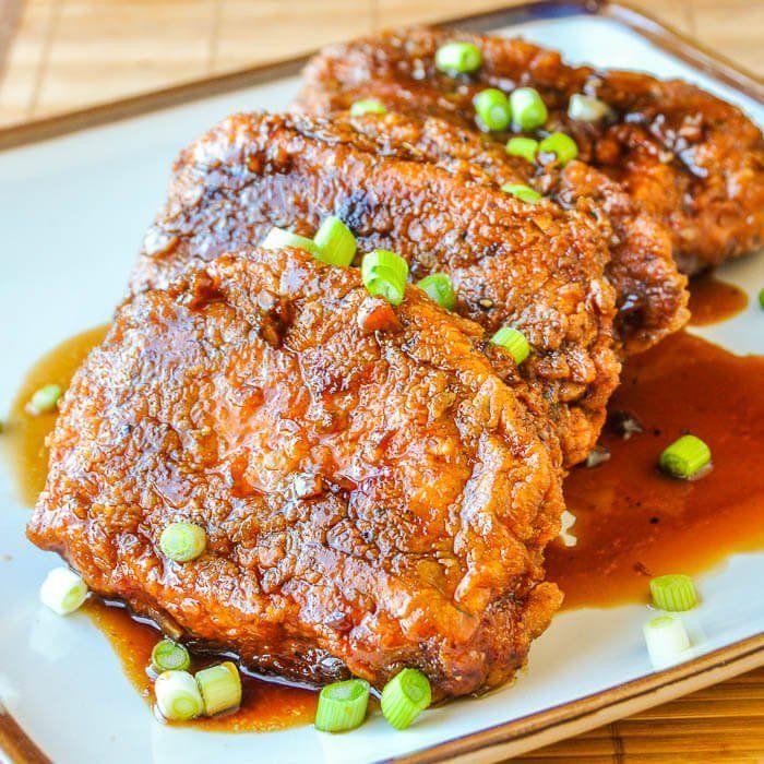 Double Crunch Honey Garlic Pork Chops - Our most popular pork recipe yet. Super crunchy yet juicy pork chops dipped in an easy to make honey garlic sauce.