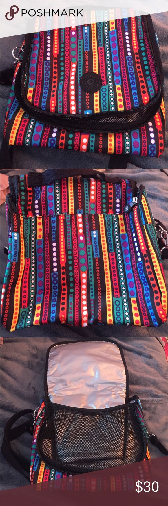 NEW Kipling Lunch Bag Brand New and never used colorful Kipling lunch bag. Front unzips with mesh netting and silver insulation inside. Handle on top of lunch bag and longer adjustable cross body strap. Comes with gorilla key chain. Kipling Bags