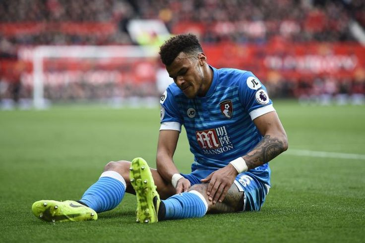 Bournemouth's English defender Tyrone Mings lies injured during the English Premier League football match between Manchester United and Bournemouth at Old Trafford in Manchester, north west England, on March 4, 2017. / AFP PHOTO / Oli SCARFF / RESTRICTED TO EDITORIAL USE. No use with unauthorized audio, video, data, fixture lists, club/league logos or 'live' services. Online in-match use limited to 75 images, no video emulation. No use in betting, games or single club/league/player…