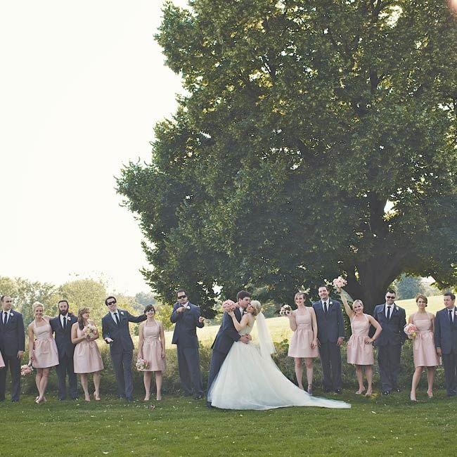 Pink bridesmaid dresses and gray groomsmen suits | Photographer: Hot Metal Studio