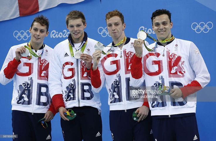 Britain's Stephen Milne, Britain's Duncan Scott, Britain's Dan Wallace and Britain's James Guy pose with their silver medal on the podium of the Men's 4x200m Freestyle Relay Final during the swimming event at the Rio 2016 Olympic Games at the Olympic Aquatics Stadium in Rio de Janeiro on August 9, 2016. / AFP / Odd ANDERSEN