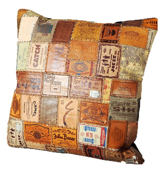 Leather pillow made of recyled jeans labels-I think I could do this for Owen's room!