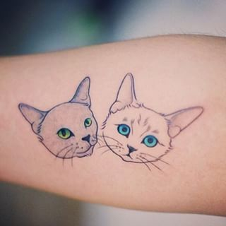 These kitties with bright eyes. | 27 Classy Cat Tattoos Every Cat Lover Will Adore