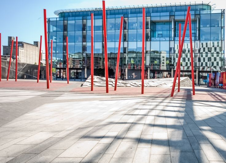 """Grand Canal Square In Dublin Docklands: The Square features a striking composition of a red """"carpet"""" extending from the theatre into and over the dock."""