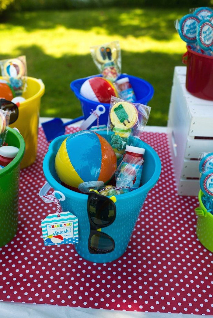 Mini beach balls and sunglasses are a must for this Colorful Pool Party via Kara's Party Ideas.