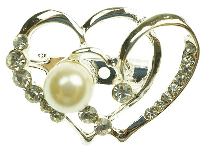 This delightful brooch is heart shaped with decoration.