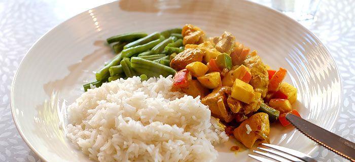 Kip madras met sperziebonen en rijst