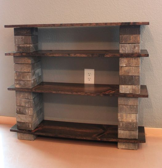 Paving blocks and wood boards create simple cheap shelving. Many different paving stones to choose from too!