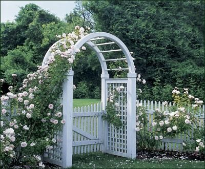 "Crafted in cellular PVC with 4 1/2"" sq. posts with 3 1/2"" sq. arch. 5' H horizontal/vertical lattice side panels. 38"" D. Side fence panels and gate sold separately. Prefinished white. Shipped kit. Motor freight."