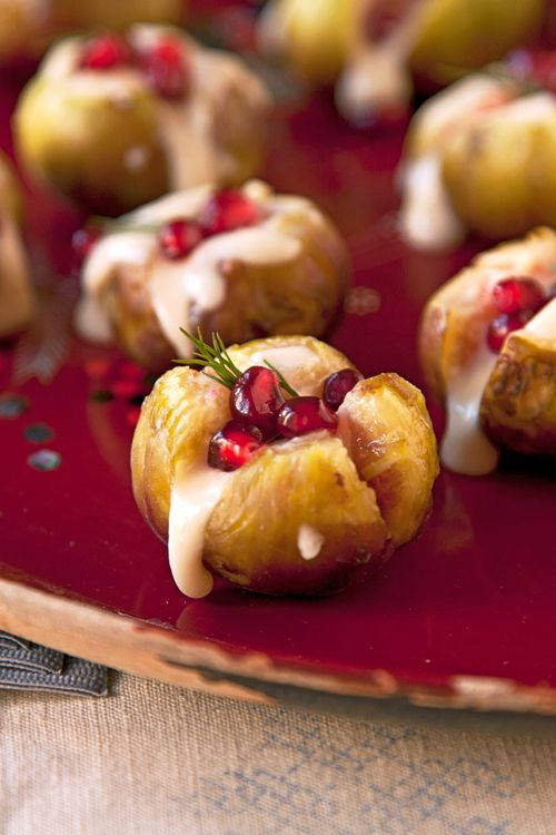 Robiolo stuffed figs with pomegranate garnish, yum! From One-Bite Hors d'Oeuvres - Photo Gallery | SAVEUR