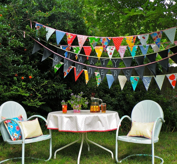 Festive Oilcloth Pennants by Modern June.  Retro chairs and table too!
