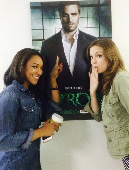Candice Patton & Danielle Panabaker (The Flash) with an Arrow poster!