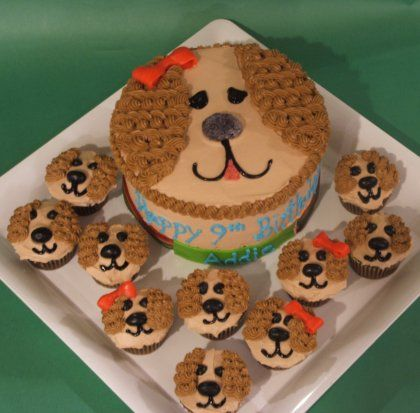 Puppy Themed Birthday Cake.  I think I'm going to do White icing all over, with Blue ears. Fondant for the eyes, nose, and bow.
