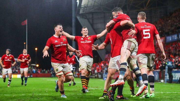 Munster celebrate Ronan O'Mahony's try to seal victory