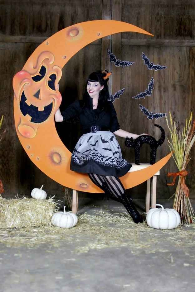 Invite guests to pose in a Halloween-themed photo booth.