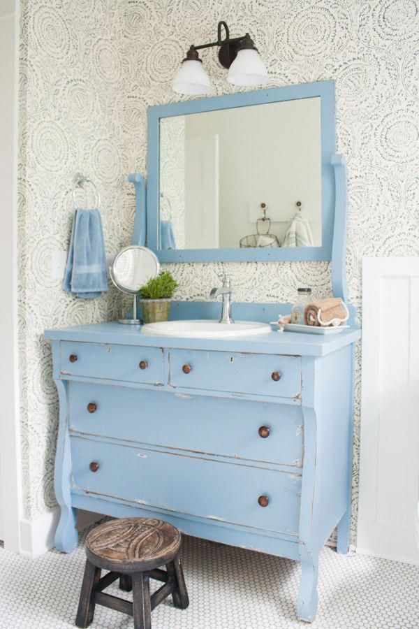 Blue and white bathroom featuring Anthropologie floral wallpaper, a