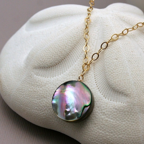 A true nautical darling will stack this abalone disc necklace with other seashell designs.