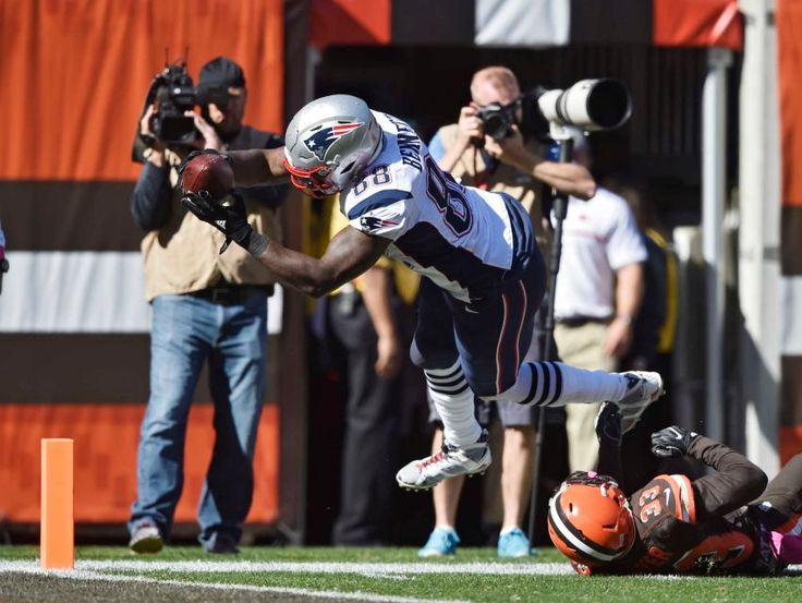 Patriots vs. Browns:     October 9, 2016   -  33-13, Patriots  -     New England Patriots tight end Martellus Bennett (88) dives over Cleveland Browns free safety Jordan Poyer (33) for a touchdown in the second half of an NFL football game, Sunday, Oct. 9, 2016, in Cleveland.