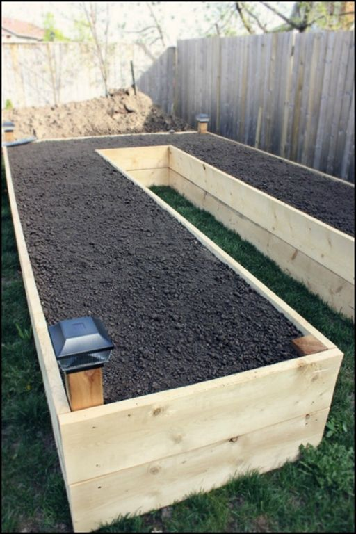 This garden bed is easy on your back, gives good drainage and allows easy access to all your plants!