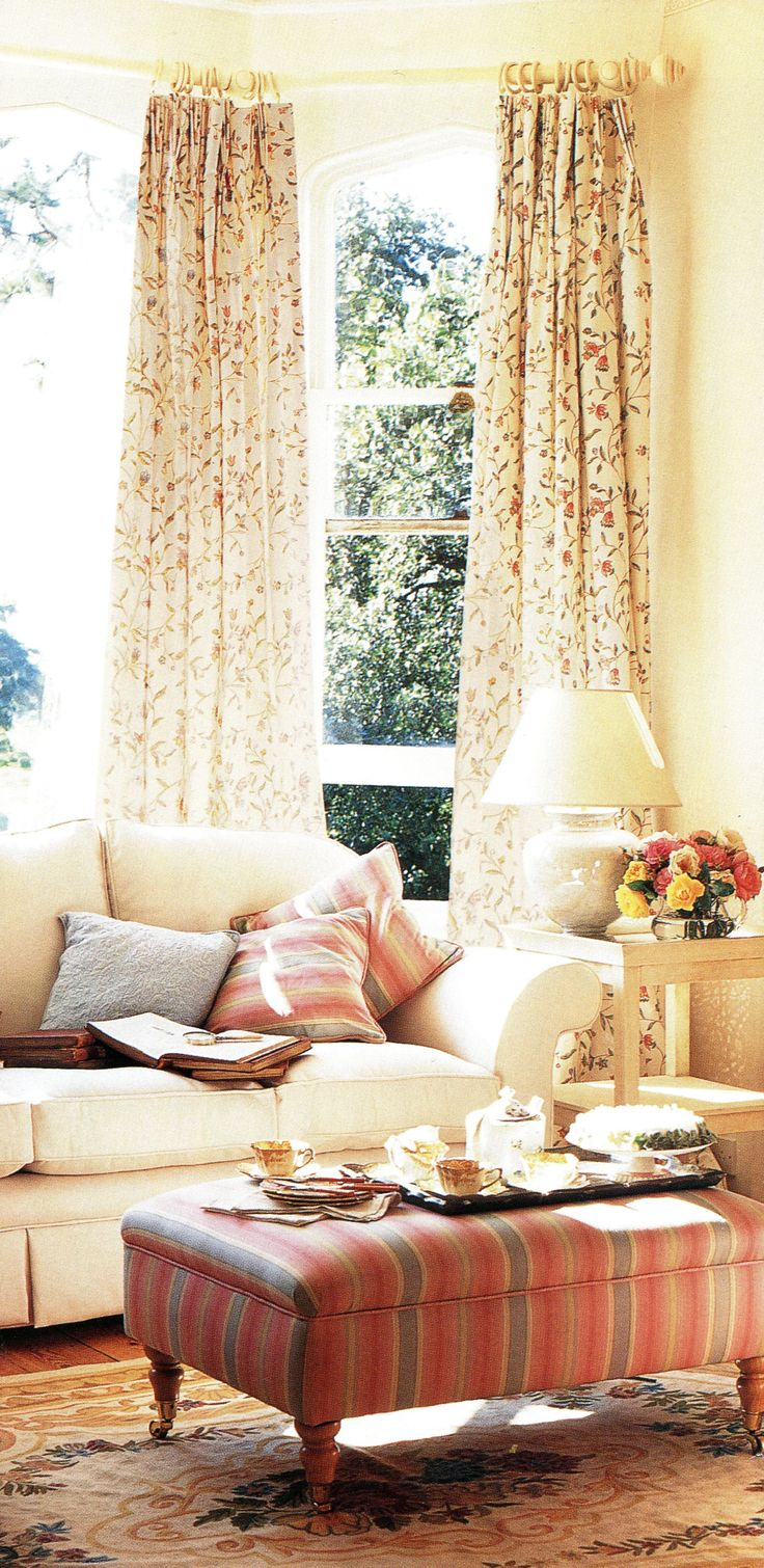 Simple heading on curtains on a cream pole that is bent into a bay window