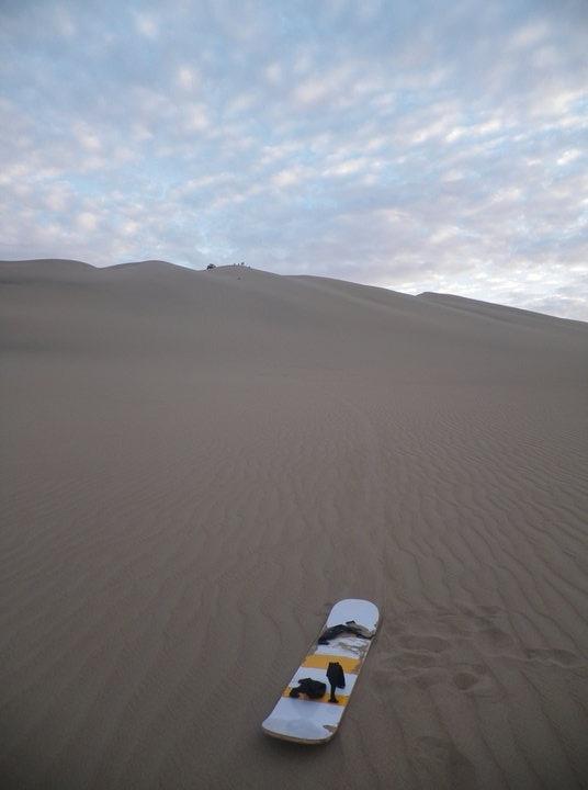 Sand boarding in huacacchina, peru