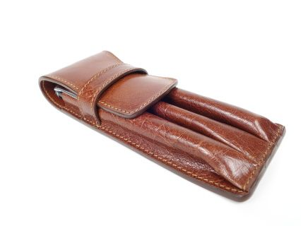 Handmade brown leather pen case. The dimensions (H 16cm/6inches x W 5.5cm /2.16inches) are enough to fit your favourite writing instrument. If it is longer than this don't worry, the flap can be adjusted so that you can use the case naturally.