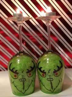 This inspires me to do something similar... much like my Grinch ornaments: I would use Pledge/green glitter on inside of glasses, duck tape-punched faces, and feather boa around top of face.  Also, would paint stems red with green polka dots... hmmmmmm...