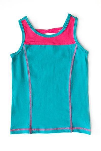Get in the game with AE Sport! Made from our signature knit, theAE Sport Tank is ready for action! This fitted tank features a crisscross strap in the back creating a trendy, athletic look. Thick tank straps provide comfort and coverage for any activity. Our matchingAE Sport skirts and shorts complete the look!  95% Cotton 5% Spandex MatchesTeal and Bright Pink Imported Comfortable fit / Stretchy Material Durable Great for play on or off the field!   Please check measurements befo...