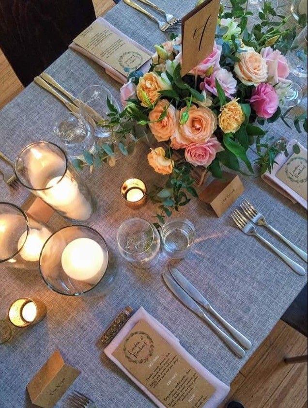 Grey tablecloths, candles, blush florals - romantic wedding tablescape