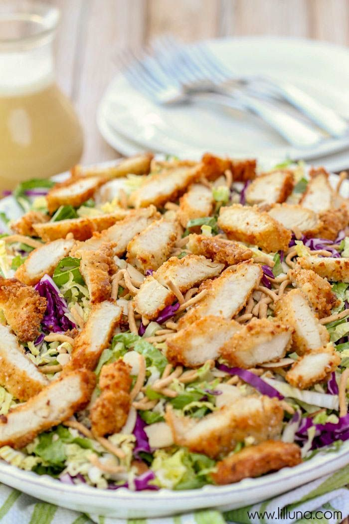 Copycat version of Applebee's Oriental Chicken Salad - one of the best salad recipes! A delicious salad made with breaded chicken, cabbage, romaine, sliced almonds, egg, cucumber, and dry chow mein in a flavorful dressing!!