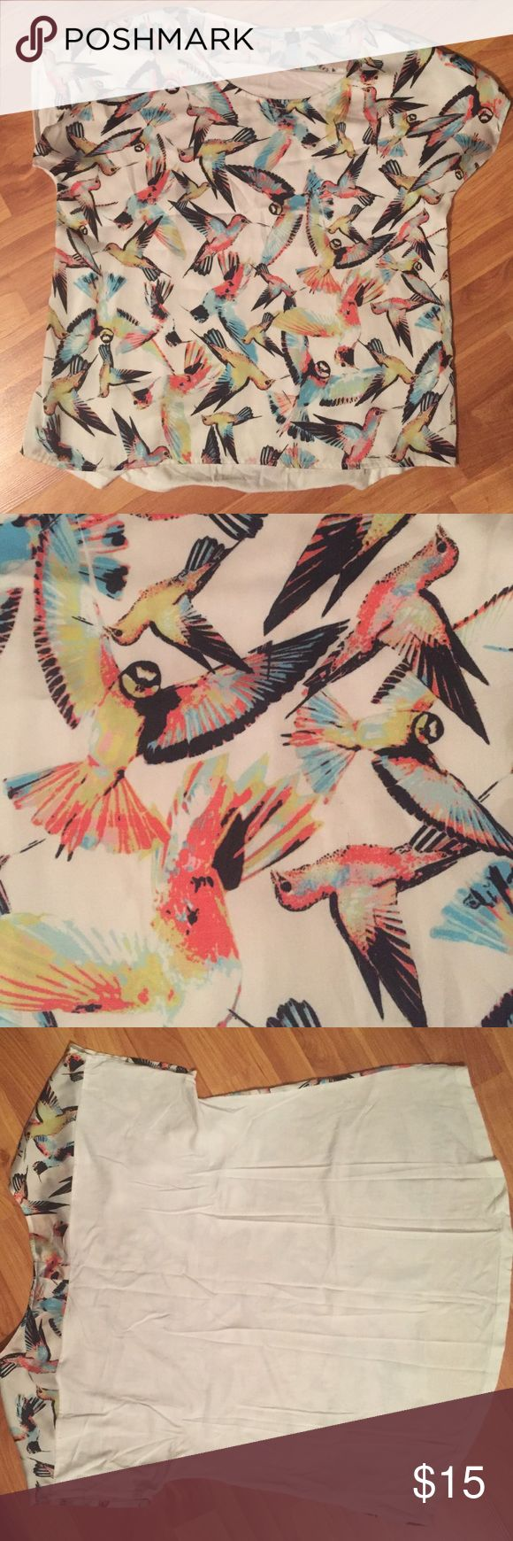 Silk and cotton bird shirt The front is a silk bird print - the back is a white cotton - gently used - in good condition Tops Blouses