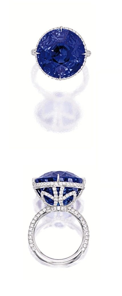 SAPPHIRE AND DIAMOND RING. Centering on a round sapphire weighing 29.30 carats, to a mount decorated by circular-cut diamonds extending to the shoulders, mounted in platinum. by AislingH