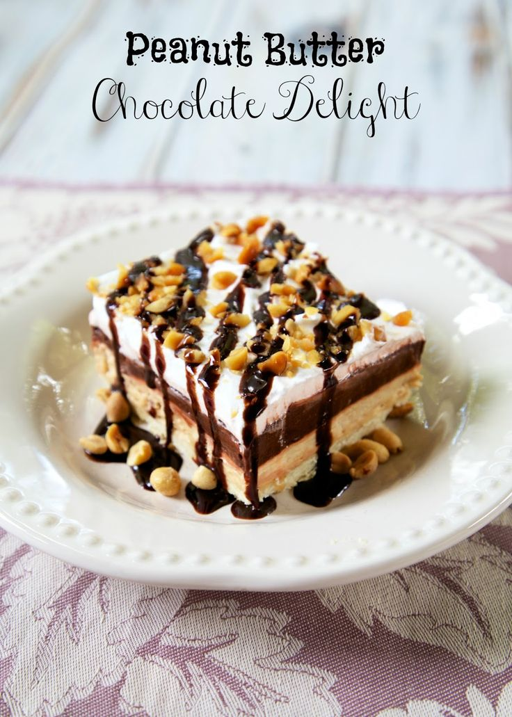 Peanut Butter Chocolate Delight - cookie crust, peanut butter cream cheese, chocolate pudding and cool whip. One bite and you'll be hooked!