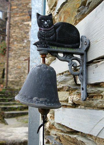 Cat bell in Piodão, the village shale (Portugal).      by Silvia Inacio