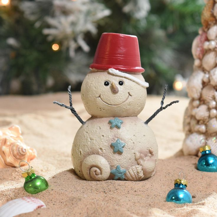 If your holiday wishes involve sand, sun, and waves, then our Sand Bucket Snowman Statue is the perfect Christmas accessory for you! This decoration makes for a cheerful, seaside companion sitting on your mantel or bookshelf.