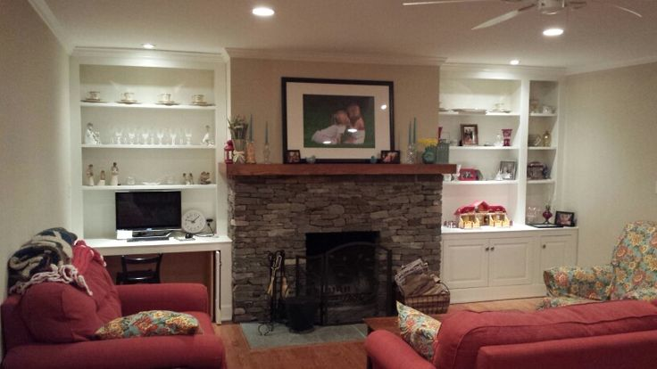 Stacked stone fireplace with built ins and computer desk ...