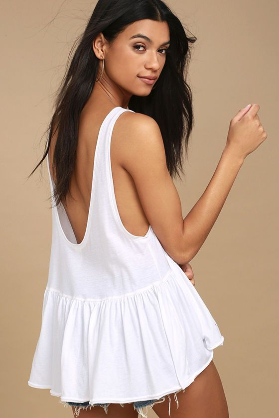 The Free People Cantina White Tank Top is always the life of the fiesta! Soft jersey knit shapes a rounded neckline and wide-cut sleeveless bodice. Scoop back and flirty, ruffled hem.
