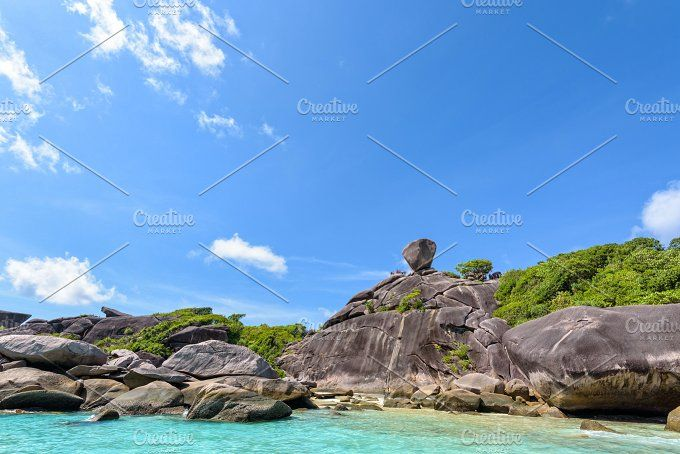 Mu Ko Similan National Park Photos Beautiful landscape people on rock is a symbol of Similan Islands, blue sky and cloud over the sea d by Yongkiet